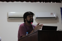 Delivering Lecture at Seminar